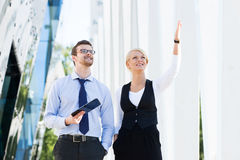 Business couple in formalwear walking outdoor Royalty Free Stock Photos