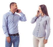 Business couple with gadgets Royalty Free Stock Photography