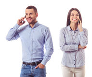 Business couple with gadgets Royalty Free Stock Photos