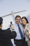 Business Couple Giving Pose For A Photo Click At Airfield Royalty Free Stock Photo