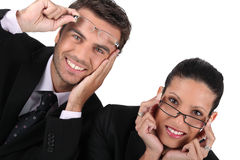 Business couple in glasses Stock Photos