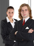 Business couple on gray background Royalty Free Stock Images