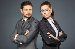 Business couple on grey Stock Photo