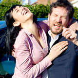 Business couple having fun laughing hugging each other Royalty Free Stock Photos