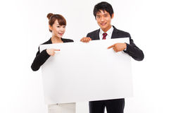 Business couple holding a add banner. Business couple holding a add banner isolated on white background Royalty Free Stock Photography
