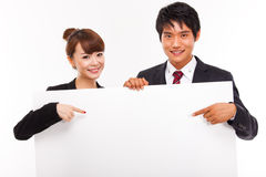 Business couple holding a add banner. Royalty Free Stock Photos