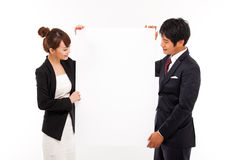 Business couple holding a add banner. Business couple holding a add banner isolated on white background Stock Image