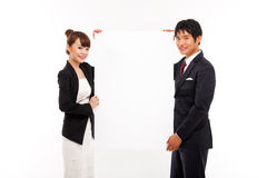 Business couple holding a add banner. Business couple holding a add banner isolated on white background Royalty Free Stock Image