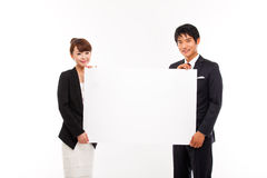 Business couple holding a add banner. Royalty Free Stock Image