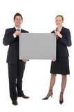 Business couple holding blank sign Royalty Free Stock Images