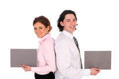 Business couple holding blank signs Stock Photography