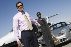 Business Couple Holding Hands At Airfield Royalty Free Stock Images