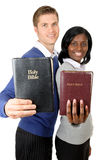 Business couple holding up bibles. This is an image of a business couple holding up bibles stock images