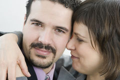 Business couple hugging Royalty Free Stock Photos
