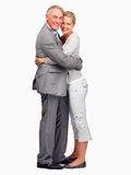 Business couple hugging eachother over white ba Stock Photography