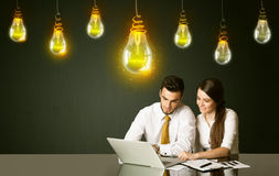 Business couple with idea bulbs Royalty Free Stock Image