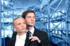 Business couple on industrial interior royalty free stock image