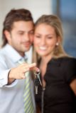 Business couple with keys Royalty Free Stock Photos