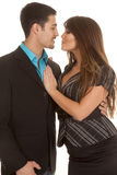 Business couple almost kissing stock photography