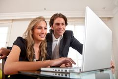 Business couple on a laptop Stock Image