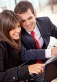 Business couple on a laptop Stock Images