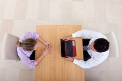 Business couple with laptop Royalty Free Stock Image