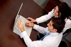 Business couple with a laptop Royalty Free Stock Images