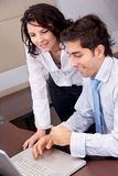 Business couple on a laptop Stock Photography