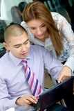 Business couple on a laptop Royalty Free Stock Images