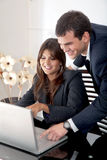 Business couple on a laptop Royalty Free Stock Image