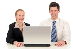 Business couple with laptop royalty free stock photo