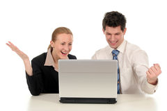 Business couple with laptop Royalty Free Stock Photography