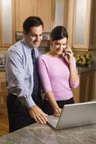 Business couple with laptop Stock Images