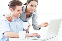Business couple with laptop Royalty Free Stock Images