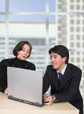 Business couple with laptop in the office Stock Images