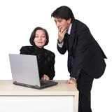 Business couple with laptop over white 2 Stock Photography