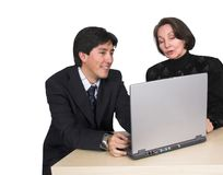 Business couple with laptop over white Royalty Free Stock Photo