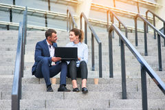 Business couple with a laptop. stock photos