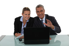 Business couple laughing Stock Photography