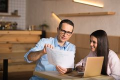 Business couple looking at documents royalty free stock image