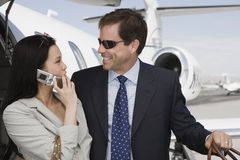 Business Couple Looking Each Other At Airfield Stock Photo