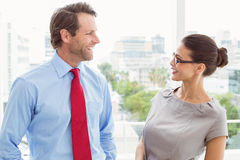 Business couple looking at each other in office Royalty Free Stock Photos