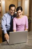 Business couple looking at laptop. Stock Photos