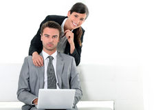 Business couple looking at a laptop Royalty Free Stock Photo