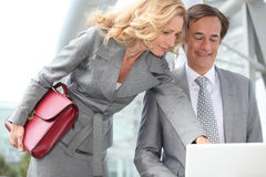 Couple looking at laptop Stock Photography