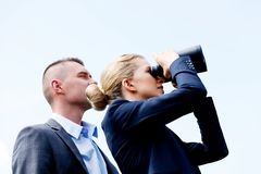Business couple looking at the sky Royalty Free Stock Images