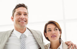 Business couple looking up in office Stock Photos
