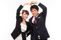 Business couple making heart symbol Stock Photo