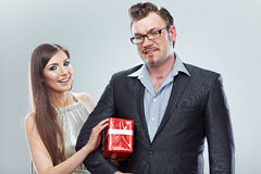 Business couple. . Man hold gift. Royalty Free Stock Images