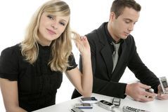Business couple with many mobile telephones Stock Photos